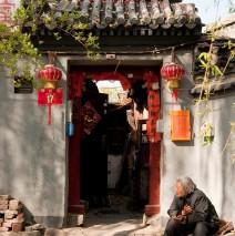 Gammal kvinna i Beijing